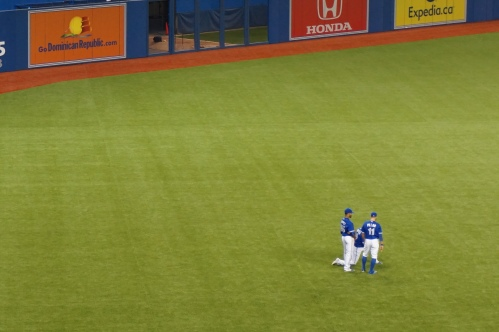 The outfield boys hanging out during a pitching change