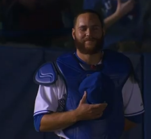 Russell Martin looks on proudly as his father plays the national anthem in Montreal